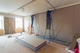 Workers Are Installing Plasterboard (drywall) For Gypsum Walls I